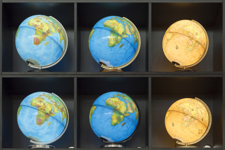 FRANKFURT, GERMANY - OCT 12, 2014: many Illuminated globes in a row at a booth of Frankfurt book fair in Frankfurt, Germany.