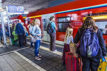 messe: FRANKFURT, GERMANY - OCT 12, 2014: people enter the subway at station Messe in  Frankfurt, Germany. During Messe events it is a  busy rapid transit station in Frankfurt. Editorial