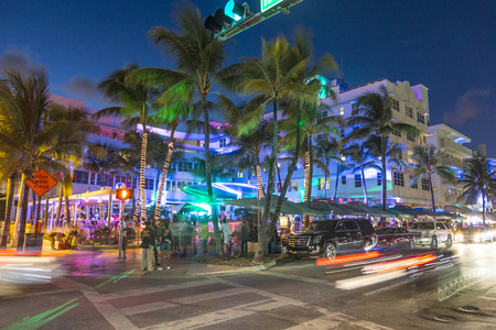 MIAMI, USA - AUG 23, 2014: Palm trees and art deco hotels at Ocean Drive by night. The road is the main thoroughfare through South Beach in Miami, USA. 報道画像