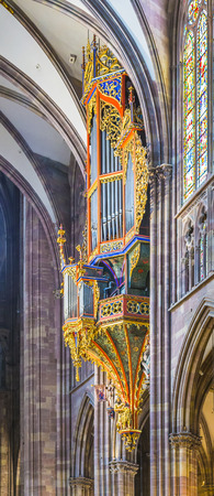 STRASBOURG, FRANCE - JULY 4, 2013: organ in the Cathedral of Strasbourg, France. The oldest sections of the actual organ case are not older than 1385.