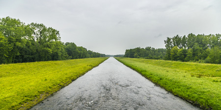 canal in Elsass in bad raining weather