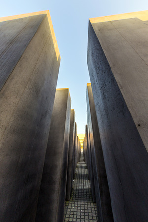 highs: BERLIN, GERMANY - OCT 29, 2014: The Holocaust monument in Berlin, Germany. It consist of 2711 concrete blocks whit different highs and parallel alignment.