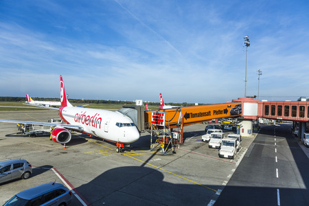 BERLIN, GERMANY - OCT 27, 2014: Air Berlin aircraft parks at the gate in  Tegel airport, Berlin, Germany. Homebase of Air Berlin is Tegel airport. 報道画像