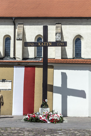 giles: KRAKOW, POLAND - MAY 4, 2014: Cross of Katyn placed on the square in front of the church St. Giles in (1990) in Krakow, Poland.