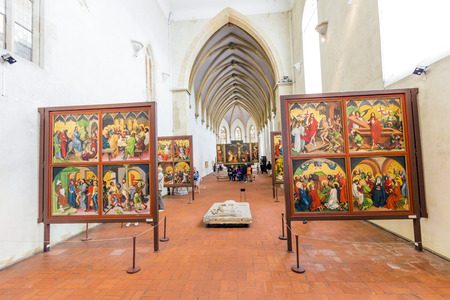 sculpted: COLMAR, FRANCE - JULY 3, 2013: people visit the Isenheim Altarpiece, sculpted and painted by the Germans Niclaus of Haguenau and Matthias Grünewald in 1512–1516 in Colmar, France. Editorial