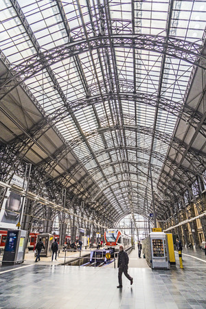 frequented: FRANKFURT, GERMANY - SEP 22, 2013: Inside the Frankfurt central station in Frankfurt, Germany. With about 350.000 passengers per day its the most frequented railway station in Germany. Editorial