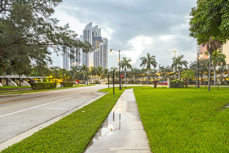 developers: SUNNY ISLES BEACH, USA - AUG 17, 2014: early morning streetview in Sunny Isles Beach, USA. It is a growing resort area and developers have invested heavily in construction of high-rise  condominiums.