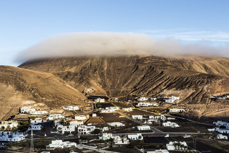 sunrise in the mountains in Femes, Lanzarote with clouds on top of volcano