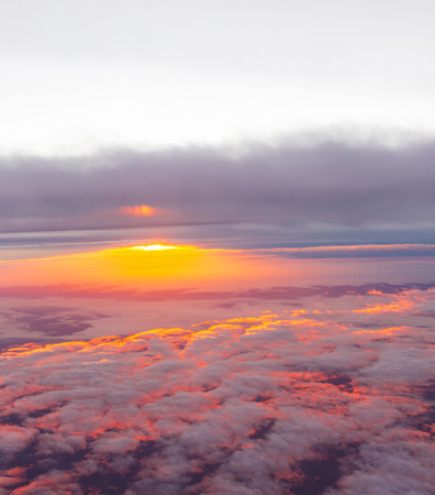 spectacular sunrise over the clouds seen from aircraft
