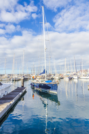 playa blanca: PLAYA BLANCA, SPAIN - NOV 18, 2014: Boats lie in the harbor Marina Rubicon in Playa Blanca, Spain. The Marina opened in 2003 and provides 500 berth for boats up to 70 m length.