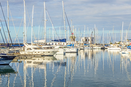 ponton: PLAYA BLANCA, SPAIN - NOV 18, 2014: Boats lie in the harbor Marina Rubicon in Playa Blanca, Spain. The Marina opened in 2003 and provides 500 berth for boats up to 70 m length.