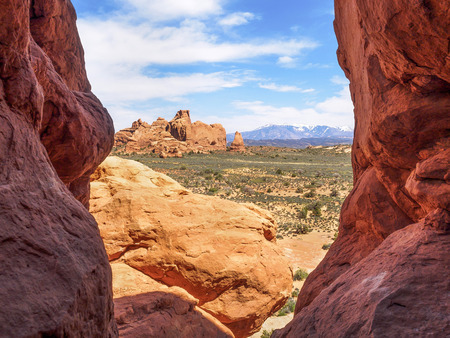 Snowcapped Mountains and Rock Formations at Arches National Park photo