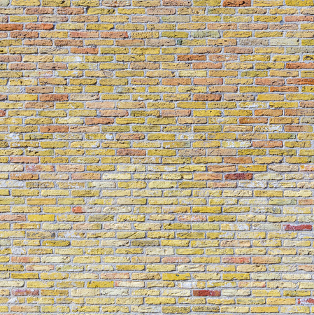 harmonic: old harmonic brick wall background  in yellow