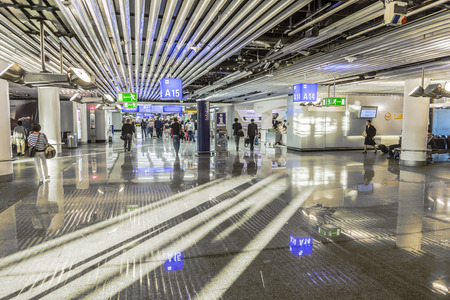 internationally: FRANKFURT, GERMANY - JULY 27, 2014: people at the airport in the morning in Frankfurt, Germany. In 2012 Frankfurt handled 57.5 million passengers. Editorial