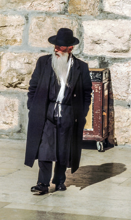 JERUSALEM - JANUARY 1 1994:  Orthodox jewish man prays at the Western Wall in Jerusalem, Israel. Israels annexation of East Jerusalem in 1967, including the Old City, was never internationally recognized.