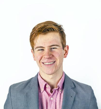 pubertad: atractivo retrato de ni�o sonriente riendo en la pubertad en el estudio Foto de archivo