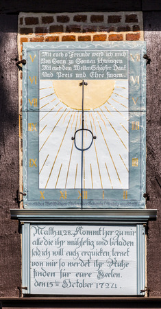 sun dial: OSTERHEIDE, GERMANY - APRIL 12,, 2014: famous old sun dial at the church in Osterheide, Germany. A sundial is a device that tells the time of day by the position of the Sun.