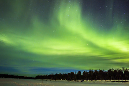 snowscape: Northern Lights (Aurora borealis) over snowscape. Stock Photo