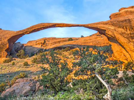 Iconic arching rock formation at dawn near Moab, Utah photo