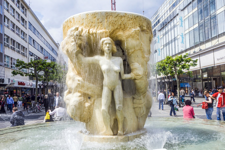 finalized: FRANKFURT, GERMANY - MARCH 23, 2008: people visit famous Brockhaus fountain in the Zeil in Frankfurt, germany. The artist Lutz Brockhaus finalized the fountain in Carrara marble in 1984.