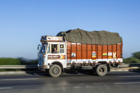 JEWAR BANGER, INDIA - NOV 12, 2011: truck uses the YAmuna express way in Jewar Banger, India. The Highway is a toll road and was finally inaugurated at August 2012.