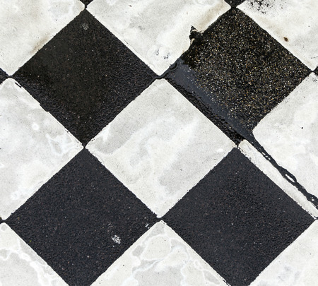 pedestrian crossing: black and white pattern od squares at the street for pedestrian crossing
