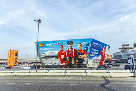 the place is important: BERLIN, GERMANY - NOV 31, 2014: advertising of aeroflot in front of the terminal in Berlin, Germany. Berlin Tegel is an important stopover place for aeroflot to flights to russia.