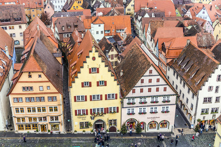 market place: ROTHENBURG, GERMANY - DEC 2, 2014: aerial of the market place of  Rothenburg ob der Tauber, Germany. The medieval town attracts over 2 million visitors every year.