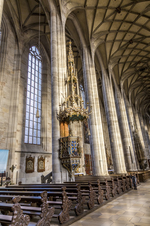 15th: DINKELSBUEHL, GERMANY - DEC 23, 2014: inside St. Georges Minster in Dinkelsbuehl, Germany. It is a  masterpiece in the Gothic style of the late 15th century  by Nikolaus Eseler.
