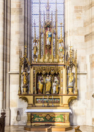 nikolaus: DINKELSBUEHL, GERMANY - DEC 23, 2014: inside St. Georges Minster in Dinkelsbuehl, Germany. It is a  masterpiece in the Gothic style of the late 15th century  by Nikolaus Eseler.