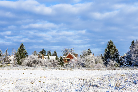 covered fields: snow covered fields with settlement at the horizon in Munich,Germany
