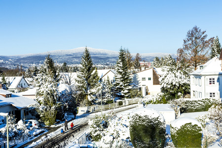 hesse: snow coverede houses and mountains in Schwalbach, Germany