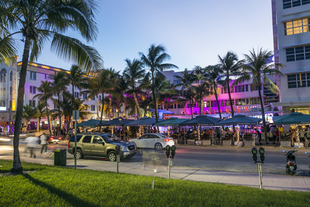 artdeco: MIAMI, USA - AUG 19, 2014: Night view at Ocean drive  in Miami, USA. Art Deco Night-Life in South Beach at ocean drive is one of the main tourist attractions in Miami.