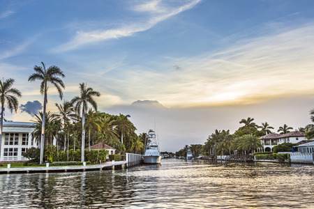 luxurious waterfront homes and yachts at the canal in Fort Lauderdale, USA 写真素材