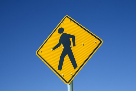 The Pedestrian crossing sign  under blue sky photo