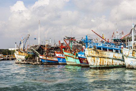 contributed: PHE, THAILAND JAN 1, 2010: fisherboats in the harbor in Phe, Thailand. In 2008  fishing contributed only 2.5 percent to GDP.