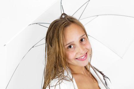 cute girl poses with umbrella in studio photo