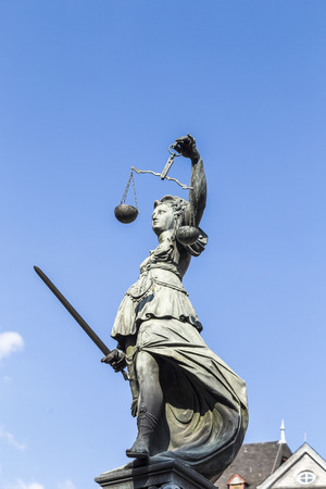 sword act: Statue of Lady Justice (Justitia) in Frankfurt, Germany