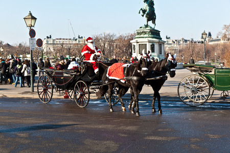 characterize: VIENNA, AUSTRIA - NOV 27, 2010: driver of the fiaker dressed as Santa Claus in Vienna, Austria. Since the 17th century, the horse-drawn carriages characterize Viennas cityscape. Editorial