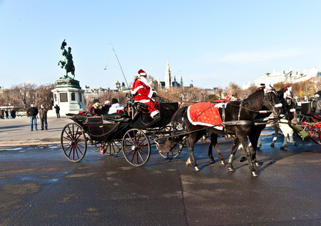 the coachman: VIENNA, AUSTRIA - NOV 27, 2010: driver of the fiaker dressed as Santa Claus in Vienna, Austria. Since the 17th century, the horse-drawn carriages characterize Viennas cityscape. Editorial