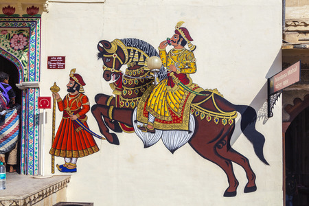wall paintings: UDAIPUR, INDIA - OCT 21, 2012: famous wall paintings show warriors in ancient times with horses in Udaipur, India. Editorial