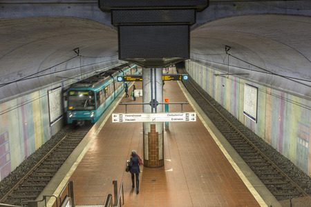 westend: FRANKFURT, GERMANY - JAN 21, 2014: people wait at the metro station for the arriving train in Frankfurt, Germany. The Metro station was inaugurated 1978 after 8 years under construction. Editorial