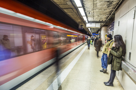 FRANKFURT, GERMANY - JAN 21, 2014: people wait at the metro station for the arriving train in Frankfurt, Germany. The Metro station was inaugurated 1978 after 8 years under construction. Editorial
