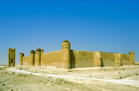 ibn: AL-SUKHNAH, SYRIA - OCT 23, 1996:  Qasr al-Hayr al-Sharqi castle in the syrian desert on Oct 23, 1996 in AlSukhnah, Syria.  It was built by the Umayyad caliph Hisham ibn Abd al-Malik in 728-29 CE in an area rich in desert fauna. Editorial