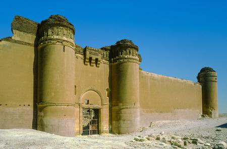 outpost: AL-SUKHNAH, SYRIA - OCT 23, 1996:  Qasr al-Hayr al-Sharqi castle in the syrian desert on  in AlSukhnah, Syria.  It was built by the Umayyad caliph Hisham ibn Abd al-Malik in 728-29 CE in an area rich in desert fauna.