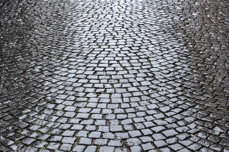 cobble: wet old historic cobble stone road