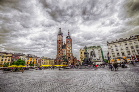 KRAKOW, POLAND - MAY 05, 2014: St. Marys Gothic Church (Mariacki Church) in Krakow, Poland. The Stare Miasto square is the centarl square in Krakow.
