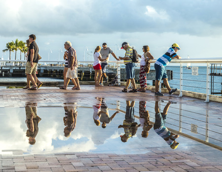 key west: KEY WEST, USA - AUG 26, 2014: people enjoy the sunset point at Mallory square in Key West, USA. This place is the most popular sunset point in Key West.