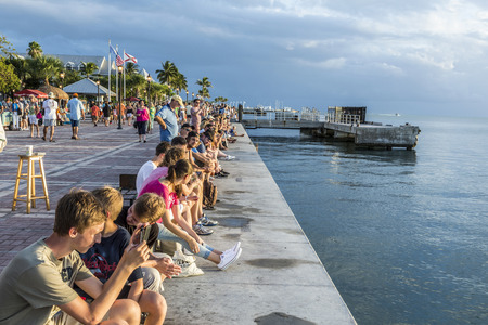 KEY WEST, USA - AUG 26, 2014: people enjoy the sunset point at Mallory square in Key West, USA. This place is the most popular sunset point in Key West.