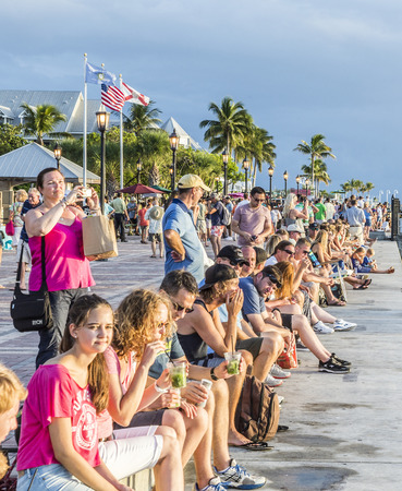 west usa: KEY WEST, USA - AUG 26, 2014: people enjoy the sunset point at Mallory square in Key West, USA. This place is the most popular sunset point in Key West.